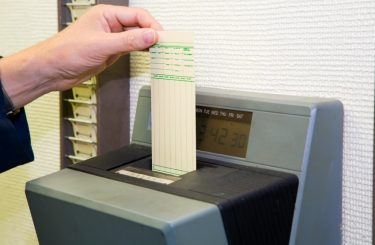 Photo of time clock and punch card